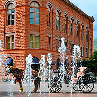 Horse and Buggy, Wheeler Opera House and Fountain in Aspen, Colorado<br /> In 1879, one of the early partners of today's Macy's department store was Jerome Wheeler. Twenty years later, this Romanesque revival opera house was built in his honor in Aspen, Colorado. The fountain also bears his name because of his significant investments in the area during the late 19th century. The horse and buggy stands between the two landmarks.