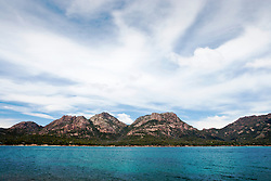 View across the water from Coles Bay to the Hazards, Freycinet, Tasmania.