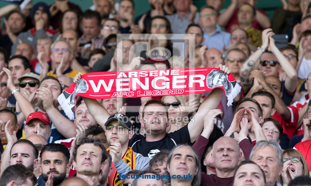 A fan holds a scarf in honour of Arsene Wenger of Arsenal during the Premier League match at the John Smiths Stadium, Huddersfield<br /> Picture by James Wilson/Focus Images Ltd 07522 978714‬‬<br /> 13/05/2018