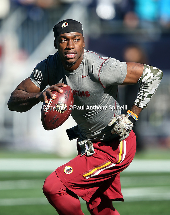 Washington Redskins quarterback Robert Griffin III (10) rolls right while looking to pass while warming up before the 2015 week 9 regular season NFL football game against the New England Patriots on Sunday, Nov. 8, 2015 in Foxborough, Mass. The Patriots won the game 27-10. (©Paul Anthony Spinelli)