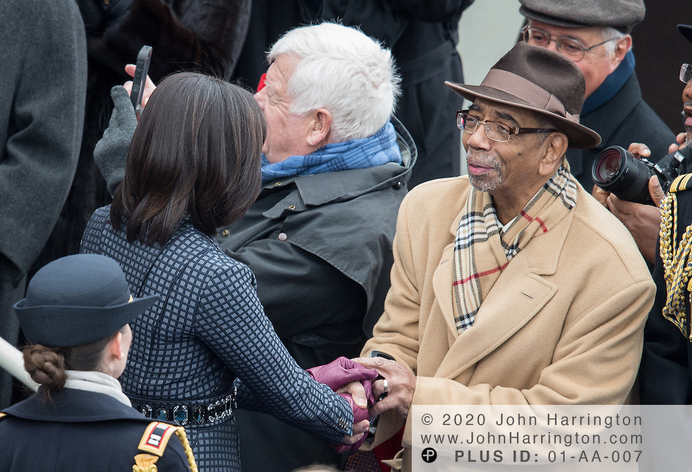Michelle Obama greets Rep. Bobby Rush at the 57th Presidential Inauguration of President Barack Obama at the U.S. Capitol Building in Washington, DC January 21, 2013.