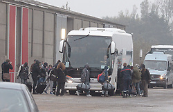 "Migrants board buses after registering at a processing centre in ""the jungle"" near Calais, northern France, as the mass exodus from the migrant camp begins."