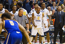 Dec 17, 2016; Morgantown, WV, USA; West Virginia Mountaineers players celebrate as their team reached 100 points during their game against the UMKC Kangaroos at WVU Coliseum. Mandatory Credit: Ben Queen-USA TODAY Sports