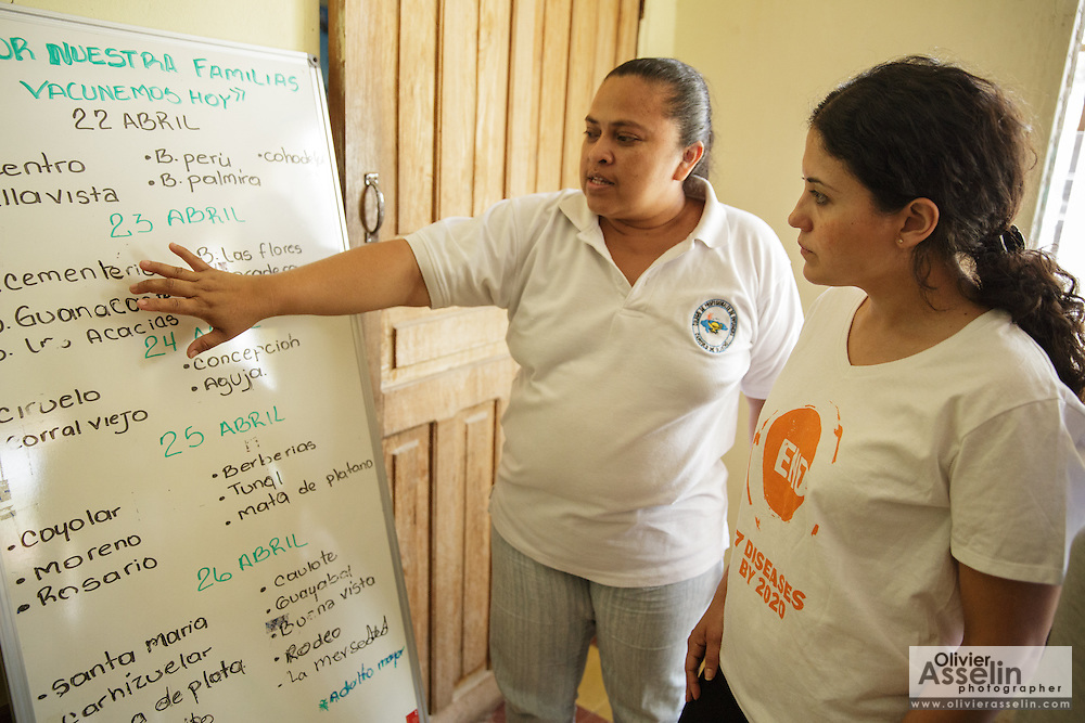 Sabin Institute senior program officer Karen Palacio, (right) listens to a health worker tell her about an ongoing vaccination campaign at the health center in San Esteban, Honduras on Thursday April 25, 2013.