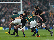 Ma'a Nonu of New Zealand gets to grips with Damian De Allende of South Africa during the 2015 Rugby World Cup semi final match at Twickenham Stadium, Twickenham<br /> Picture by Michael Whitefoot/Focus Images Ltd 07969 898192<br /> 24/10/2015