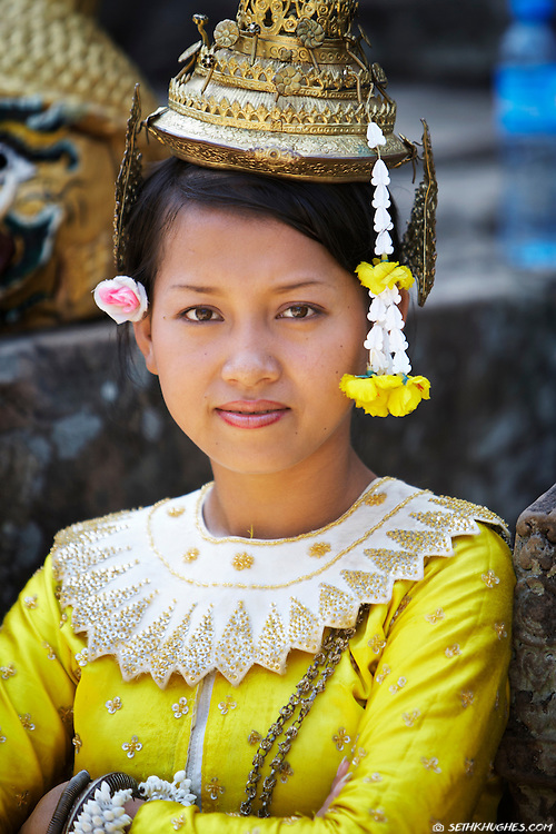 A Cambodian woman dressed in traditional ceremonial garb at the temple grounds of Angkor Wat in Siem Reap, Cambodia