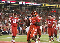 September 16, 2017 - Houston, TX, USA - Houston Cougars running back Mulbah Car (34) rushes for a touchdown during the second quarter of the college football game between the Houston Cougars and the Rice Owls at TDECU Stadium in Houston, Texas. (Credit Image: © Scott W. Coleman via ZUMA Wire)