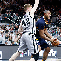 02 April 2017: Utah Jazz center Boris Diaw (33) drives past San Antonio Spurs forward Davis Bertans (42) during the San Antonio Spurs 109-103 victory over the Utah Jazz, at the AT&T Center, San Antonio, Texas, USA.