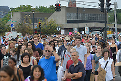 August 19, 2017 - Boston, Massachusetts, U.S - Bostonians march toward the Common against racial hatred and President Trump and a group of ''Free Speech'' demonstrators who they consider Nazis. (Credit Image: © Kenneth Martin via ZUMA Wire)