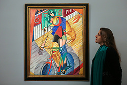 © Licensed to London News Pictures. 29/01/2020. London, UK. A staff member views Jean Metzinger's painting titled Le cycliste (est £1.5m to £2m) at the preview of Sotheby's Impressionist, Modern and Surrealist art sales. The auction will take place at Sotheby's in central London on 4 and 5 February 2020. Photo credit: Dinendra Haria/LNP