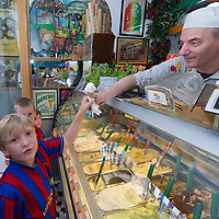 VENICE, ITALY - JUNE 30:   Three young customers buy  ice cream from Carlo Pistacchi's Gelateria Alaska in Santa Croce on June 30, 2011 in Venice, Italy. Carlo has been making ice-cream using fresh ingredients for more than 25 years and is renowned for experimenting with new flavours, offering his customers classic favourites such as rum and raisin or chocolate as well as some of his more unconventional creations such as asparagus or rocket salad and orange.