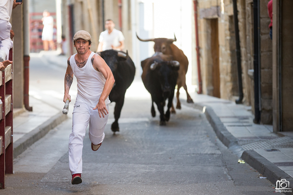 American author and bull runner Bill Hillmann runs in the encierro during the Youth Fiestas of Carcastillo in preparation for the bull runs of Sanfermines in Carcastillo, Spain, on June 24, 2017. (Stan Olszewski/SOSKIphoto)