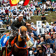 "MINAMISOMA, JAPAN - JULY 24 :  A samurai horseman is seen after completing the race in the Kacchu-keiba (armed horse race) during the Soma Nomaoi festival at Hibarigahara field on Sunday, July 24, 2016 in Minamisoma, Japan. ""Soma-Nomaoi"" is a traditional festival that recreates a samurai battle scene from more than 1,000 years ago. (Photo: Richard Atrero de Guzman/NURPhoto)"