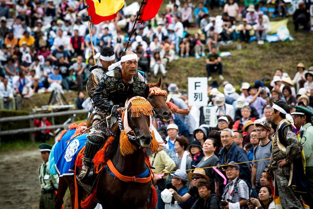 "MINAMISOMA, JAPAN - JULY 24 :  A samurai horseman is seen after completing the race in the Kacchu-keiba (armed horse race) during the Soma Nomaoi festival at Hibarigahara field on Sunday, July 24, 2016 in Minamisoma, Japan. ""Soma-Nomaoi"" is a traditional festival that recreates a samurai battle scene from more than 1,000 years ago. (Photo: Richard Atrero de Guzman/NURPhoto)"