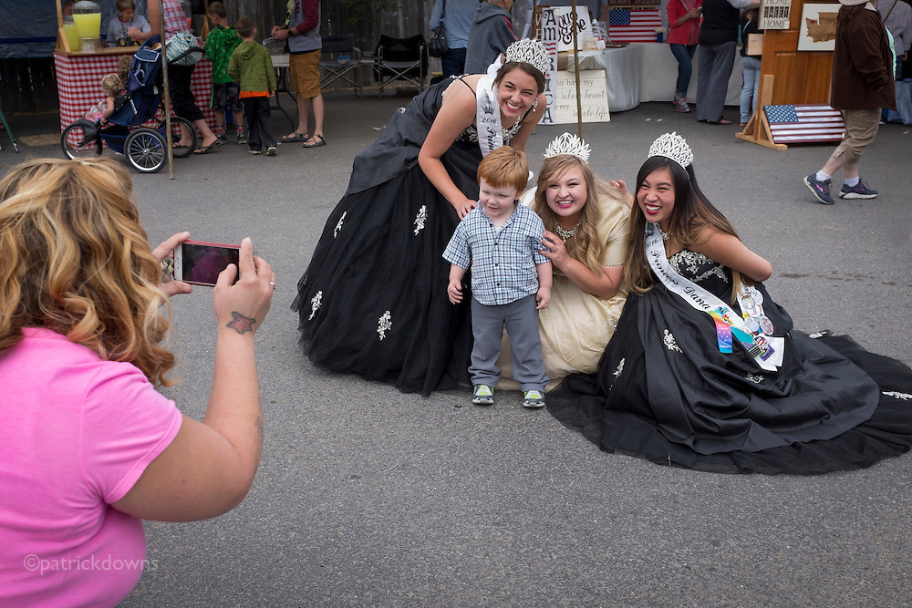 A lad gets snapped by mom with the Princesses at Joyce Daze, in Joyce WA west of Port Angeles.