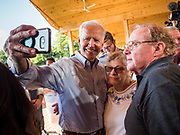 20 AUGUST 2019 - PROLE, IOWA: Former Vice President JOE BIDEN poses for a selfie with a couple after his campaign appearance in Prole. Vice President Biden is campaigning in Iowa to be the Democratic nominee for the US Presidency. He spoke to about 200 people in Prole Tuesday afternoon. Iowa traditionally hosts the first event of the presidential election cycle. The Iowa caucuses are Feb. 3, 2020.          PHOTO BY JACK KURTZ