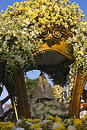 The wooden statue of the Virgin is locked into the Berlinda. The canopy which will be carried along the procession.
