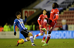 Wigan Athletic's Bo-Kyung Kim competes with Cardiff City's Kenwyne Jones - Photo mandatory by-line: Richard Martin-Roberts/JMP - Mobile: 07966 386802 - 24/02/2015 - SPORT - Football - Wigan - DW Stadium - Wigan Athletic v Cardiff City - Sky Bet Championship