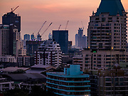 08 MARCH 2019 - BANGKOK, THAILAND: Construction cranes dot the skyline at sunset over Bangkok as seen from the EmQuartier, an upscale mall on Sukhumvit Rd.    PHOTO BY JACK KURTZ
