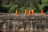 Buddhist monks walking on the Terrace of the Elephants, Angkor Thom, Siem Reap, Cambodia