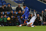 Hull City Temita Olufisayo Olaluwa Aina (34) slides tackles  Cardiff City  Nathaniel Mendez-Laing (19) during the EFL Sky Bet Championship match between Cardiff City and Hull City at the Cardiff City Stadium, Cardiff, Wales on 16 December 2017. Photo by Gary Learmonth.
