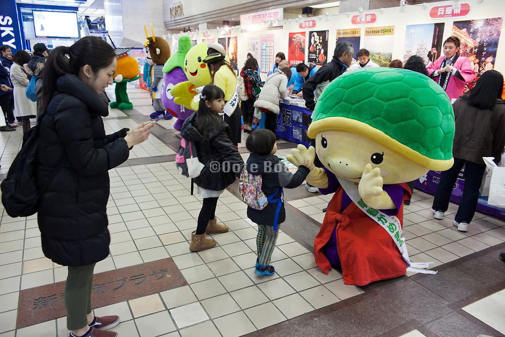 Japanese Yuru chara mascot family event with happy children