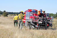 A controlled prairie burn was conducted Sept. 22, 2016 at the Pacific Rim Institute in Coupeville, Wash. The purpose of the burn was to elimate non-native plant species, enrich soil, and promote germination of native plants that will preserve and protect an endangered ecosystem. Photo by Michael Watkins