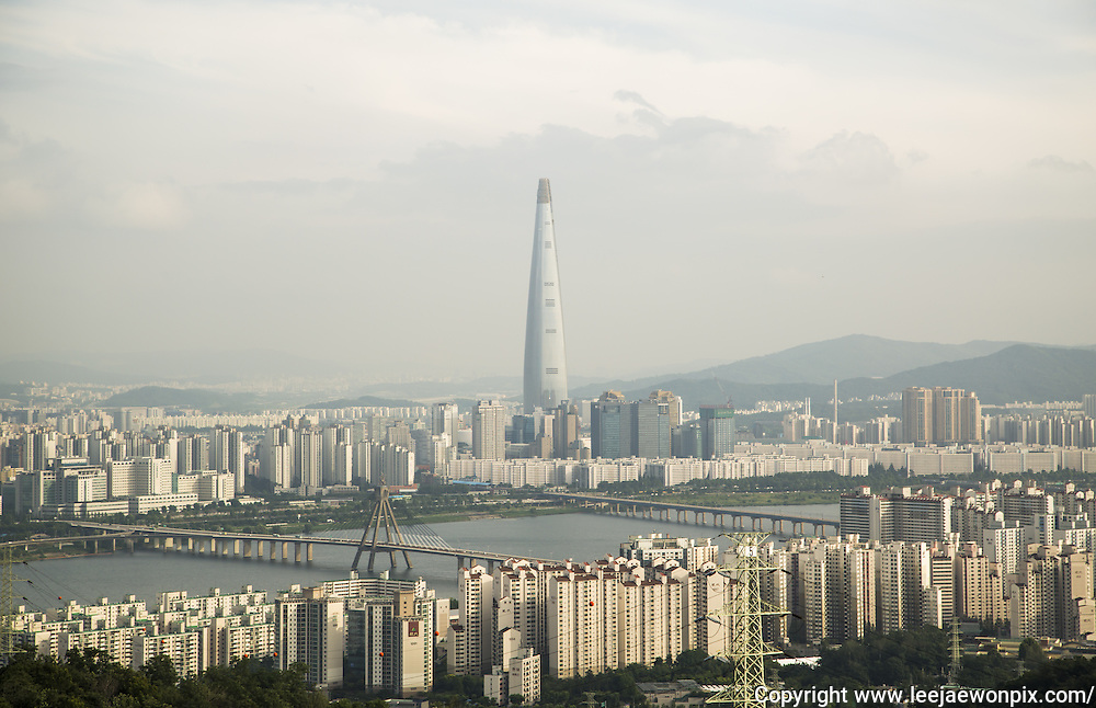 The 123-story Lotte World Tower is seen in Seoul, South Korea, June 24, 2016. According to local media, building the tower had been opposed by South Korea's air force from the early 1990s to late 2000s, which insisted that the tower would hinder military aircrafts' movement from the Seoul Military Airport nearby the tower but the administration of former South Korean President Lee Myung-Bak approved the project in 2009, with Lotte Group bearing charges to turn the angle of the Seoul Airport's eastern runway by 3 degrees, so that aircraft flight paths would be moved away from the tower. The tallest tower in South Korea will be completed this year. The Lotte Group is recently under prosecution investigation for alleged slush funds and embezzlement, local media reported. Photo by Lee Jae-Won (SOUTH KOREA)  www.leejaewonpix.com
