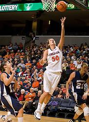 Virginia forward Chelsea Shine (50) shoots against MU.  The Virginia Cavaliers women's basketball team defeated the Monmouth Hawks 71-45 at the John Paul Jones Arena in Charlottesville, VA on December 18, 2008.