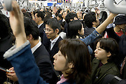 full train with commuters in Tokyo Japan