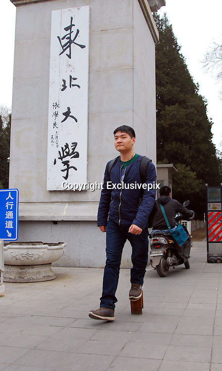 SHENYANG, CHINA - MARCH 28: (CHINA OUT)<br /> <br /> Man Has One Leg Shorter 23 CM Than The Other<br /> <br /> 27-year-old Zhao Qiang walks on March 28, 2014 in Shenyang, Liaoning Province of China.  Zhao had multiple chondroma when he was 2-year-old which made his left leg grow slower than the right one,  Zhao got an idea to wear a wooden bench on his left leg to keep balance. Hear has been wearing the wooden bench for 14 years. <br /> &copy;Exclusivepix