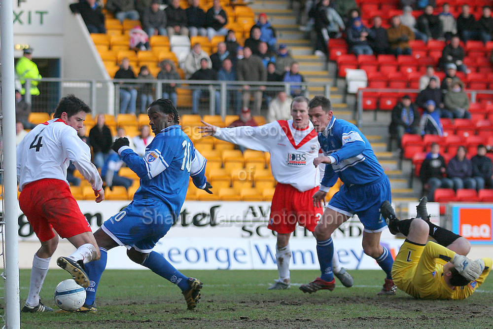 Airdrie Utd's Stuart Taylor fails to stop Jason Scotland scoring for St Johnstone in the Scottish First Division match played at Mc Diarmid Park 20th January 2007.