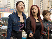3 girls walking in the streets Beijing China