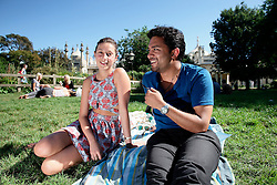 UK ENGLAND BRIGHTON 8SEP16 - Li (24, L) of Brighton and Victor Roy (29) of Chicago enjoy the sunshine in a park at the Brighton Pavillion.<br /> <br /> jre/Photo by Jiri Rezac<br /> <br /> © Jiri Rezac 2016
