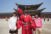 Gyeongbokgung Palace. Changing of the guard ceremony. Toursists taking souvenir shots.