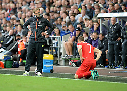Liverpool manager Jurgen Klopp looks on at James Milner of Liverpool - Mandatory by-line: Alex James/JMP - 01/10/2016 - FOOTBALL - Liberty Stadium - Swansea, England - Swansea City v Liverpool - Premier League