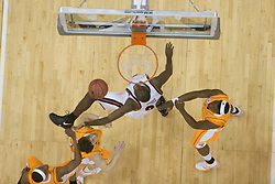 Virginia Cavaliers center Tunji Soroye (21) puts up a shot in the first half against Tennessee.  The #4 seed Virginia Cavaliers were defeated by the #5 seed Tennessee Volunteers 77-74 in the second round of the Men's NCAA Tournament in Columbus, OH on March 18, 2007.