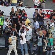 Crew members of Trevor Bayne driving the Motorcraft/Quick Lane Ford celebrate after winning the Daytona 500 Sprint Cup race at Daytona International Speedway on February 20, 2011 in Daytona Beach, Florida. (AP Photo/Alex Menendez)