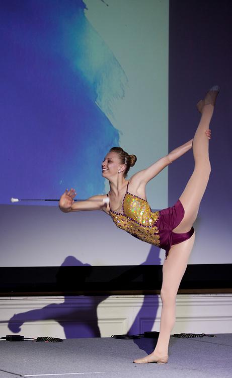 Miranda Scott twirls a baton on stage at the International Women's Day Festival in Baker Ballroom on Sunday, March 19, 2017. © Ohio University / Photo by Kaitlin Owens