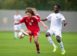 NEWPORT, WALES - Thursday, September 25, 2014: Wales' Ethan Ampadu in action against France's Aurelien Nguiamba during the Under-16's International Friendly match at Dragon Park. (Pic by David Rawcliffe/Propaganda)