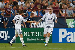 July 20, 2011; Santa Clara, CA, USA;  Vancouver Whitecaps forward Eric Hassli (29) is congratulated by defender Jonathan Leathers (25) after scoring a goal against the San Jose Earthquakes during the first half at Buck Shaw Stadium.