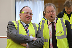 © Licensed to London News Pictures. 29/02/2016. FILES IMAGE: Antrim, Northern Ireland, SENIOR Ulster Unionist's MP Danny Kinahan (right) stands beside his UUP colleague, Adrian Cochrane-Watson as they wait the Mayor of London, Boris Johnson MP, to arrived for during a tour of a plant in Antrim,  Northern Ireland. Local media today (March 9th, 2016) have reported that the Ulster Unionist MP Danny Kinahan received almost £23,000 in expenses to cover rent and rates for one of his constituency offices while an MLA in expenses from Stormont to pay rent on a property owned by a party colleague, Adrian Cochrane-Watson. Photo credit : Paul McErlane/LNP