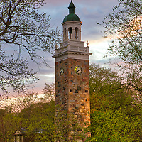 This Greater Boston area sunset photography image shows the Isaac Sprague Memorial Tower at Elm Park, also known as Clocktower Park located within Wellesley Hills, MA. Wellesley is part of the Metro West region of Massachusetts and is only a few miles west of Boston. <br />