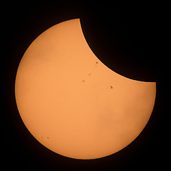 The International Space Station, with a crew of six onboard, is seen in silhouette as it transits the Sun at roughly five miles per second during a partial solar eclipse, Monday, Aug. 21, 2017 near Banner, Wyoming.  Onboard as part of Expedition 52 are: NASA astronauts Peggy Whitson, Jack Fischer, and Randy Bresnik; Russian cosmonauts Fyodor Yurchikhin and Sergey Ryazanskiy; and ESA (European Space Agency) astronaut Paolo Nespoli. A total solar eclipse swept across a narrow portion of the contiguous United States from Lincoln Beach, Oregon to Charleston, South Carolina. A partial solar eclipse was visible across the entire North American continent along with parts of South America, Africa, and Europe.  Photo Credit: (NASA/Joel Kowsky)  Please note: Fees charged by the agency are for the agency's services only, and do not, nor are they intended to, convey to the user any ownership of Copyright or License in the material. The agency does not claim any ownership including but not limited to Copyright or License in the attached material. By publishing this material you expressly agree to indemnify and to hold the agency and its directors, shareholders and employees harmless from any loss, claims, damages, demands, expenses (including legal fees), or any causes of action or allegation against the agency arising out of or connected in any way with publication of the material.