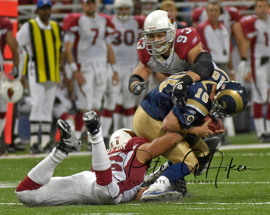 Arizona Cardinal defenders Chris Cooper (93) and Chike Okeafor (56) sack St. Louis quarterback Marc Bulger (10) in the fourth quarter, at the Edward Jones Dome in St. Louis, Missouri, December 3, 2006.  The Cardinals beat the Rams 34-20.<br />