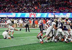 UCF Knights kicker Matthew Wright's attempted field goal is deflected by Auburn University defenders during the second half of the Chick-fil-A Peach Bowl NCAA college football game at the Mercedes-Benz Stadium in Atlanta, January 1, 2018. UCF won 34-27 to go undefeated for the season. (David Tulis via Abell Images for Chick-fil-A Peach Bowl)