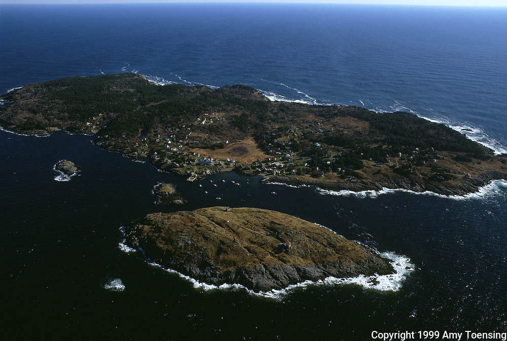 MONHEGAN ISLAND, MAINE - NOVEMBER 28: An aerial view of the island November 28, 1999 on Monhegan Island, Maine. This small, rocky island is ten miles from the nearest mainland, only accessible by boat and barely a square mile in area. Monhegan Island, home to lobstermen and painters and a popular destination for tourists is twelve miles off the coast of Maine. Ringed by high, dark cliffs, its interior a mix of meadows, marsh and spruce groves, Monhegan is one of just 14 true island communities left off the coast of Maine. The island has a 65 permanent, year-round residents and the population grows to around 200 in the summer, with day-trippers adding several hundred more. (Photo by Amy Toensing) _________________________________________<br /> <br /> For stock or print inquires, please email us at studio@moyer-toensing.com.
