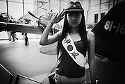 "A woman dressed in military garb and a sash that reads ""Kamikaze"" salutes next to a war-time military aircraft such as those used by Japan's kamikaze pilots at a museum in the grounds of Yasukuni Shrine in Tokyo, Japan. Every year on August 15, the day Japan officially surrendered WWII, tens of thousands of Japanese visit the controversial shrine to pay their respects to the 2.46 million war dead enshrined there, the majority of who are soldiers and others killed in WWII but also includes 14 Class A convicted war criminals, such as Japan's war-time prime minister Hideki Tojo. Each year speculation escalates as to whether the country's political leaders will visit the shrine, the last to do so being Junichiro Koizumi in 2005. Nationalism in Japan is reportedly on the rise, while sentiment against the nation by countries that suffered from Japan's wartime brutality, such as China, has been further aggravated by Japan's insistence on glossing over its wartime atrocities in school text books..Photographer:Robert Gilhooly.."