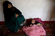 A woman and her one month old baby await their trail in prison. After the birth of the baby her husband didn't want to recognize the child and accussed the woman of adultery. She was arrested and sent to jail for the so called 'moral crime' of running away from home. Faizabad, Badakshan, Afghanistan, 2012