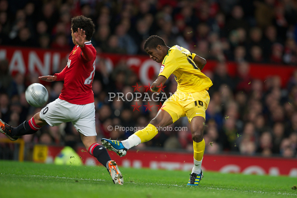 MANCHESTER, ENGLAND - Wednesday, November 29, 2011: Manchester United's Fabio Da Silva and Crystal Palace's Wilfred Zaha during the Football League Cup Quarter-Final match at Old Trafford. (Pic by David Rawcliffe/Propaganda)